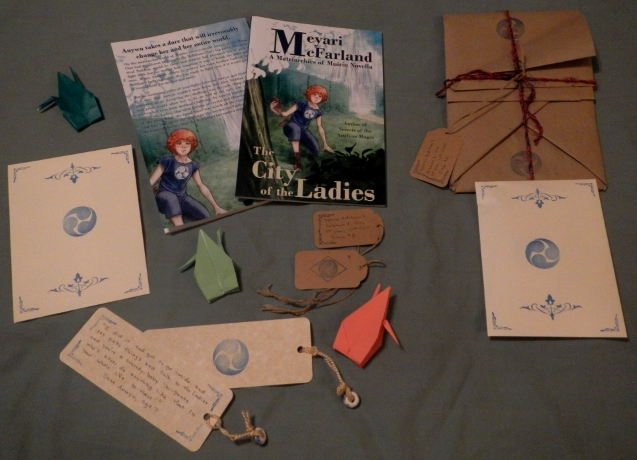 Picture showing all items included in the special edition of The City of the Ladies
